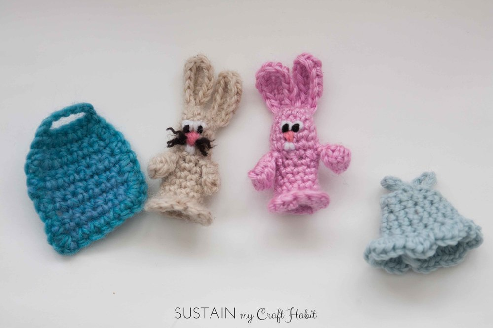 Make a pair of adorable crochet bunny finger puppets. These little rabbits with detachable outfits make a fun little Easter or spring gift for kids. The free DIY pattern is included. SustainMyCraftHabit
