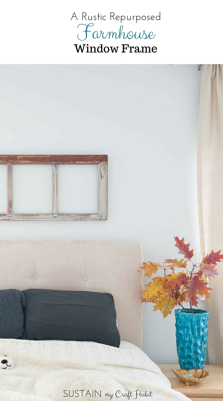 An old farmhouse window frame is upcycled and repurposed into a beautiful DIY home decor piece for the bedroom wall. A rustic home decor idea by SustainMyCraftHabit.
