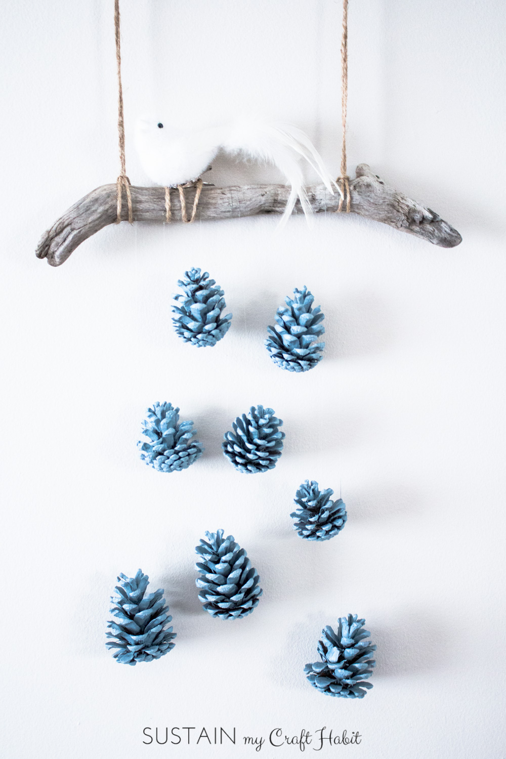 A Beautiful Bird Perched Above A Cascading Array Of Robinu0027s Egg Blue  Pinecones Makes A Beautiful