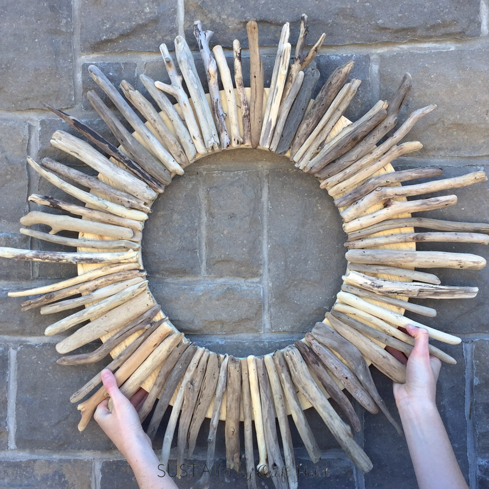 Beautiful DIY Driftwood Wreath. Follow this step-by-step tutorial to create your own round wreath using driftwood pieces. Perfect rustic decor for the front door or coastal cottage.