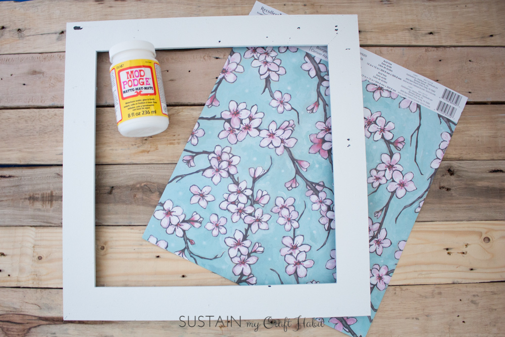 Give a new look to old or outdated photo frames using decorative scrapbook paper and a crafting essential: Mod Podge! Step-by-step instructions are included for this simple DIY home decor upcycling idea.