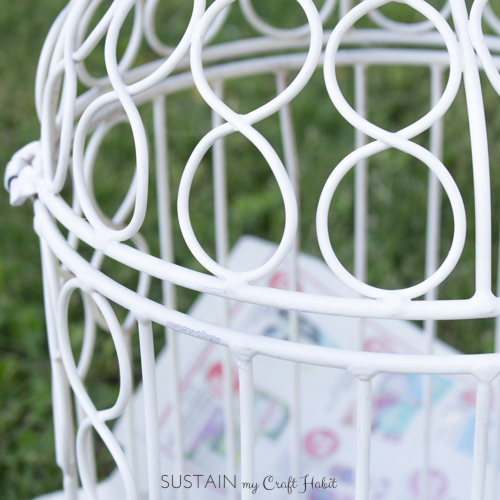 Easy DIY ideas for upcycling old metal outdoor decor using spray paint. Love the pine-cone filled birdcage idea!