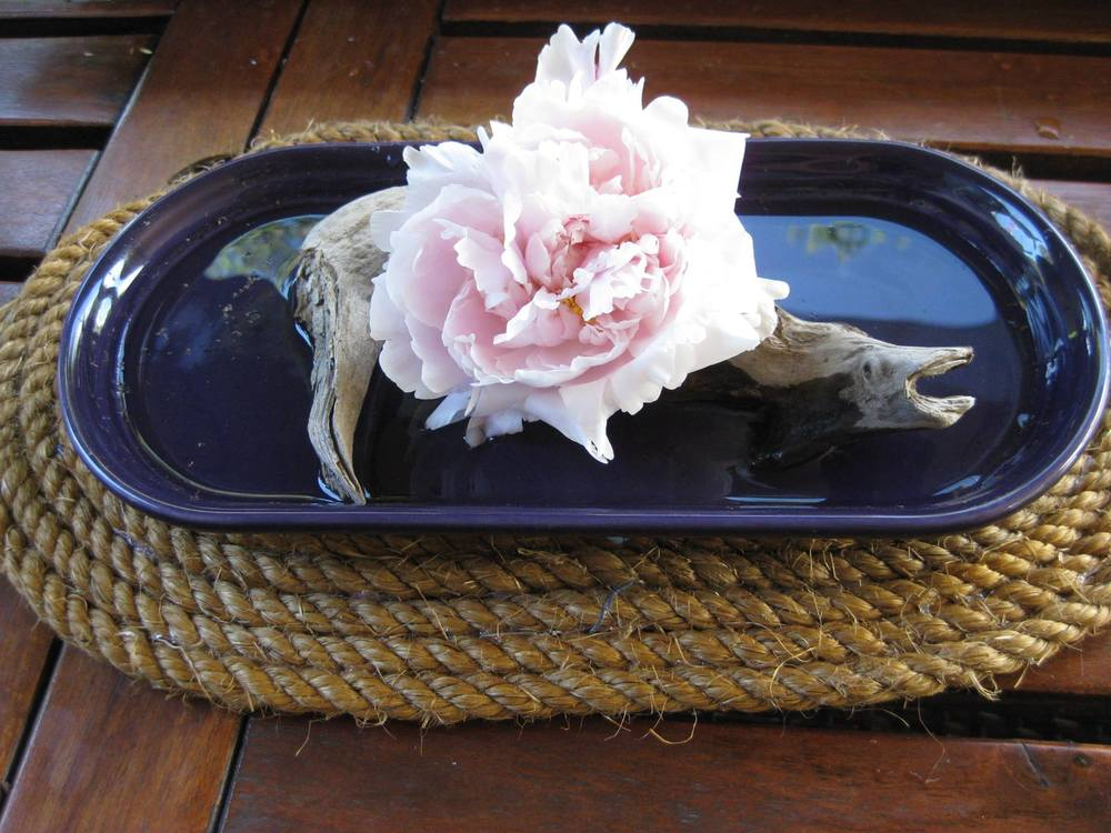 Driftwood and peony centerpiece by Charlotte Howes