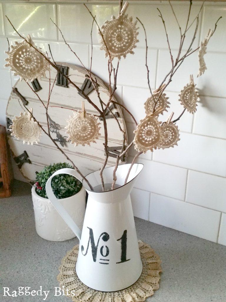 Twig tree doily flowers by Sam Hay