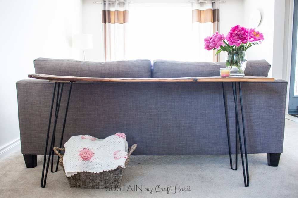 Looking for a rustic and functional home decor project for your entry-way? Check out this step-by-step tutorial to make a reclaimed barn wood console table with trendy hairpin legs. The perfect DIY furniture piece for your home!