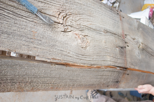 Splitting a piece of barn board to reveal the live edge for this trendy home decor furniture project.