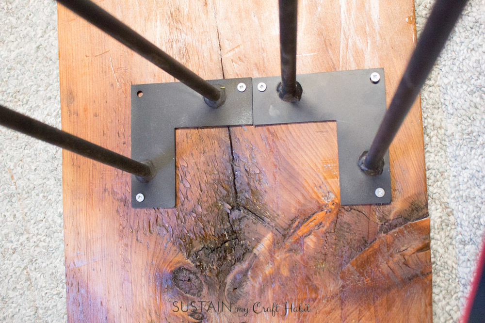 How to assemble hairpin legs onto a DIY narrow console table made with reclaimed barn wood.