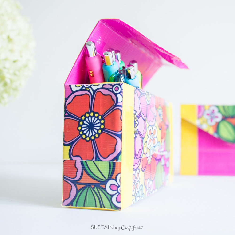 How to make your own bright and cheery pencil case with an empty cardboard snack box and Duck Tape! So many color combo possibilities. Click through to see the full step-by-step tutorial for this easy DIY back-to-school craft.