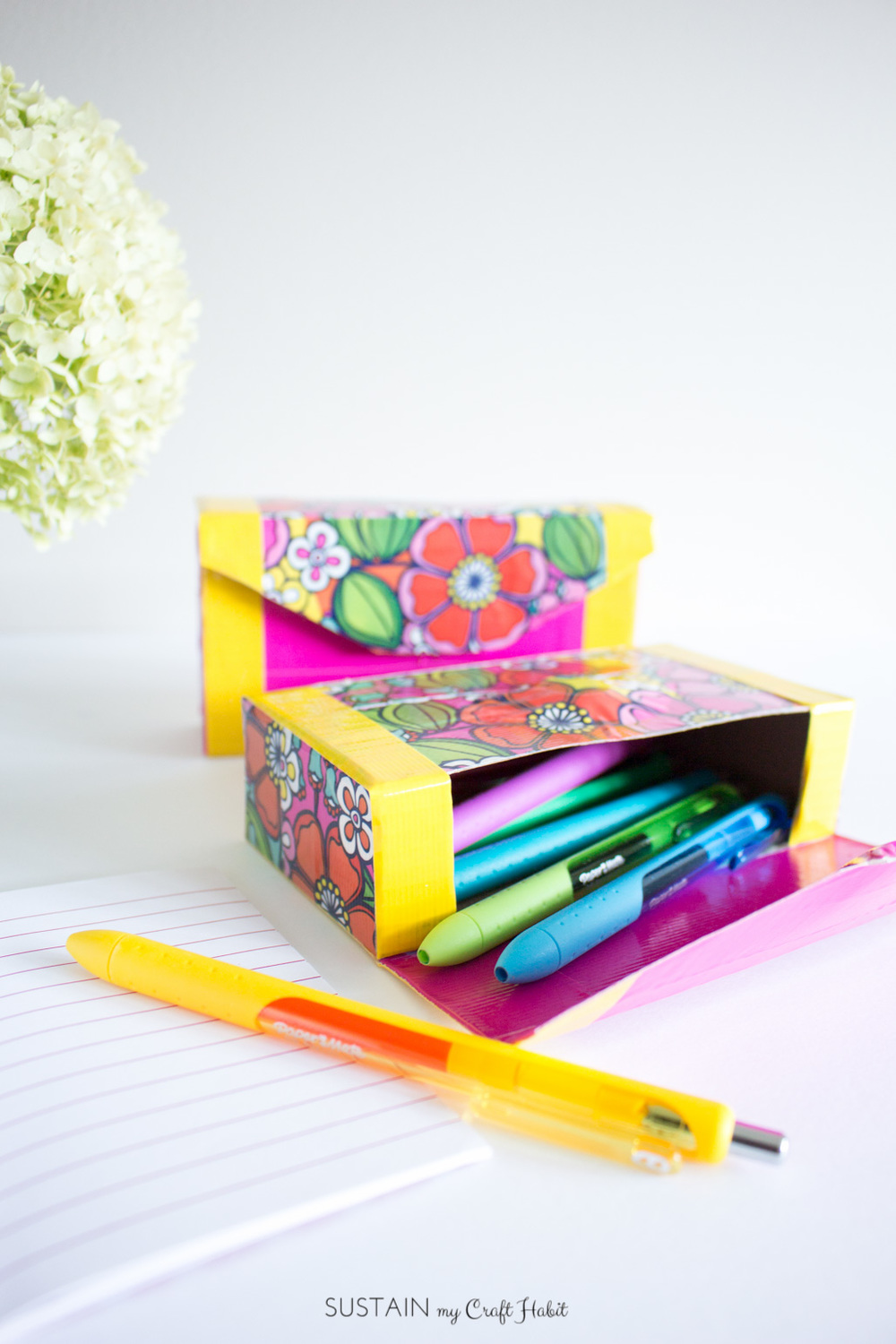 How to make your own bright and cheery pencil case with an empty cardboard snack box and Duck Tape! So many color combo possibilities!