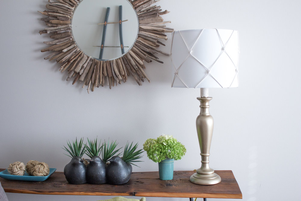 A dated table lamp gets a fresh nautical makeover with a new lampshade and coat of metallic paint. Click through for the step-by-step tutorial for this DIY home decor upcycling idea.