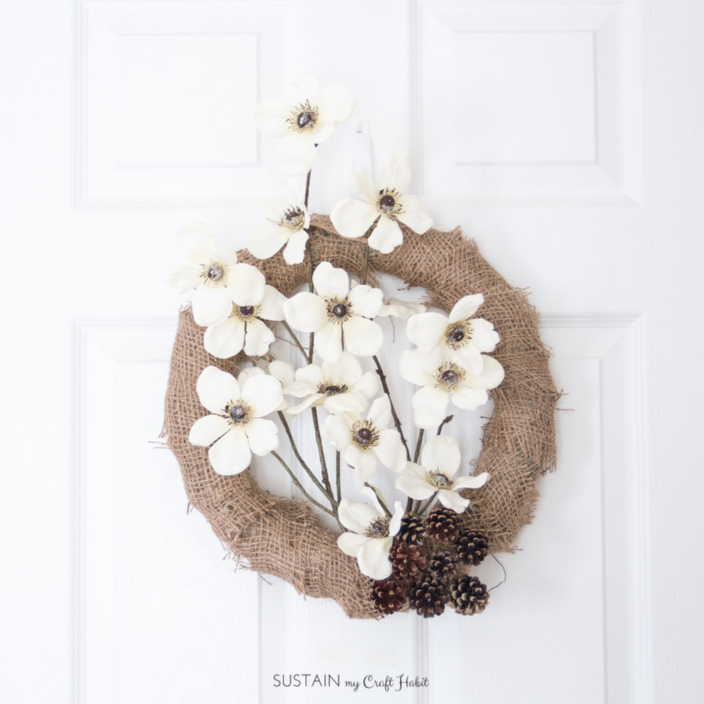 Make an easy and rustic wreath for the fall with a few materials including faux flowers and burlap. Click through for the step-by-step tutorial including video for this beautiful home decor idea!