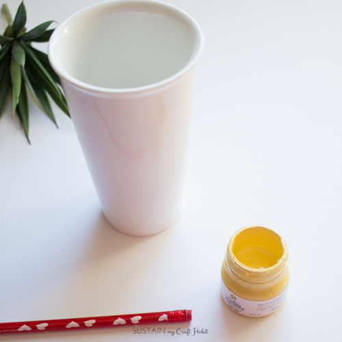 Upcycle a plain ceramic mug with paint and a Sharpie marker.