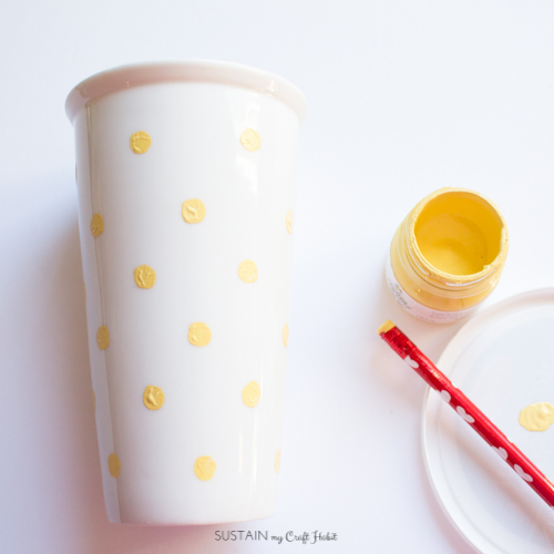 Personalize your own travel mug with yellow polka dots.