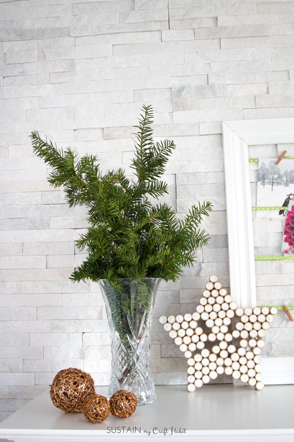 Foraged winter greens for a rustic Christmas fireplace mantel | Scandinavian style holiday mantle decorating ideas