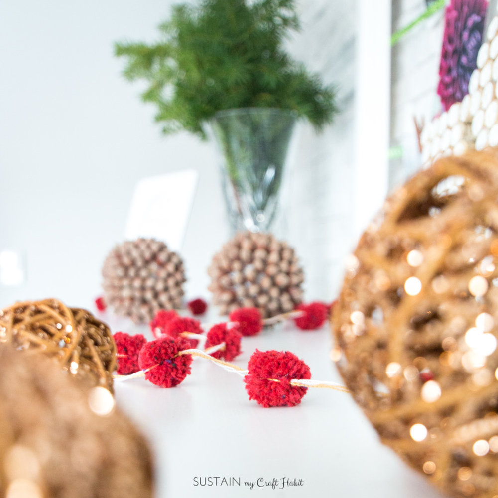 Red and copper string pom pom garland