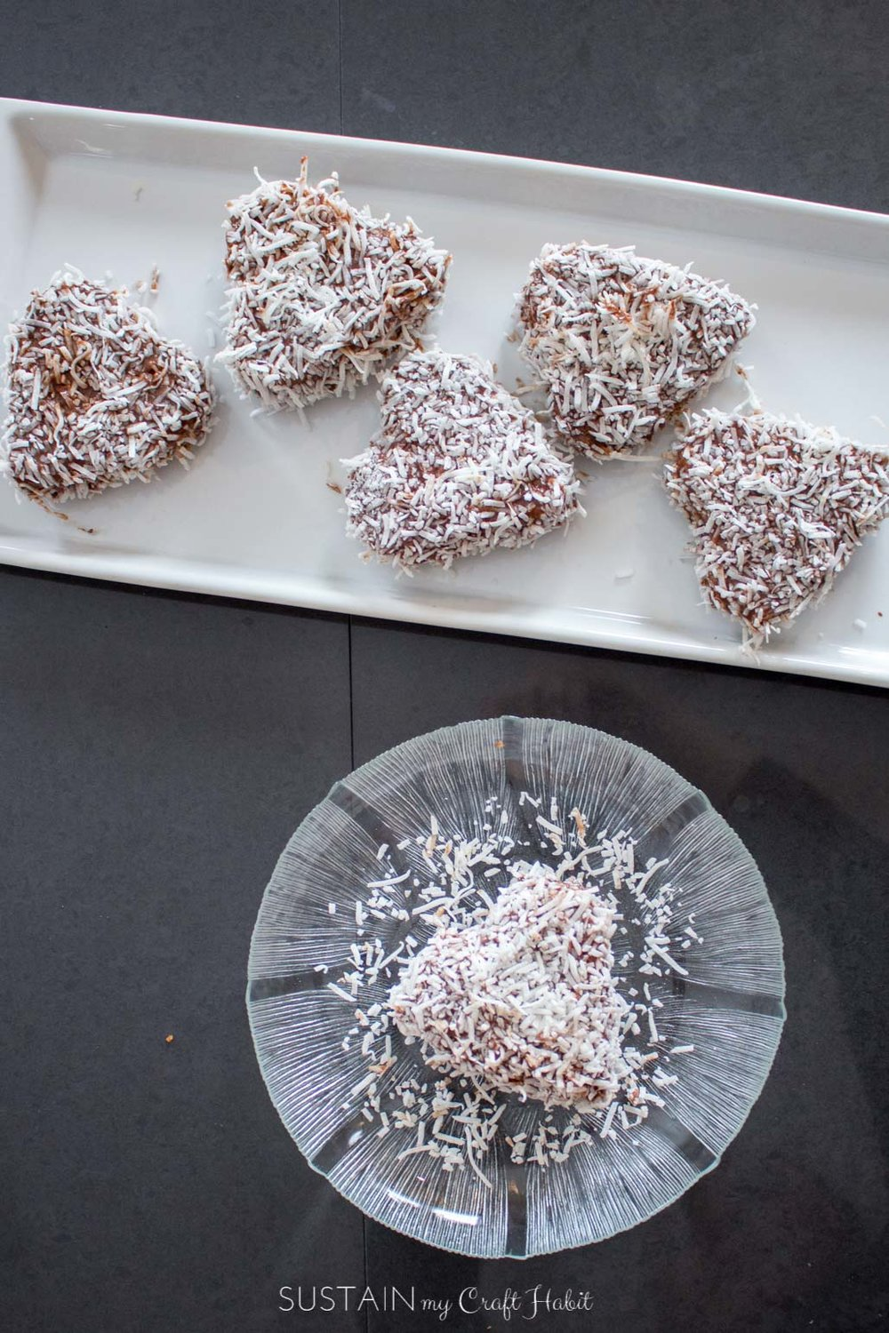 How sweet are these mini heart-shaped personal cakes? Very simple recipe with chocolate and coconut. Easy homemade dessert ideas: great for a potluck, shower or wedding sweets table.