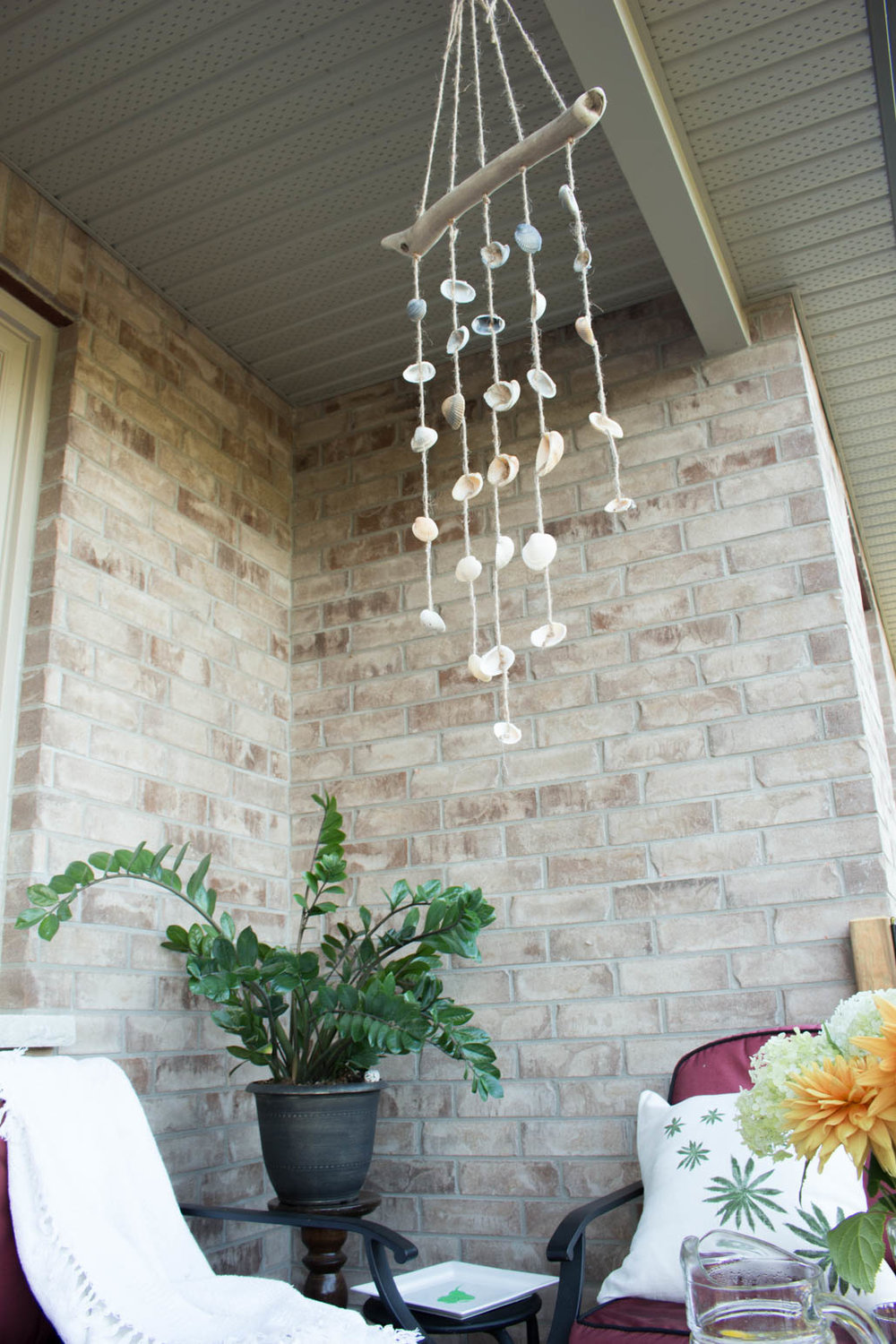 This seashell wind chime is so easy to make and can be used indoors as acoastal cottage décor idea for your patio or bring it indoors as wall art. A quick DIY video tutorial is included to make this nautical project!