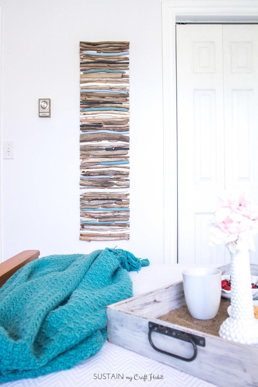 DIY Coastal Decor - Painted Driftwood Wall Art | Driftwood craft project | Lake house or cottage decorating idea | Cheap driftwood decor