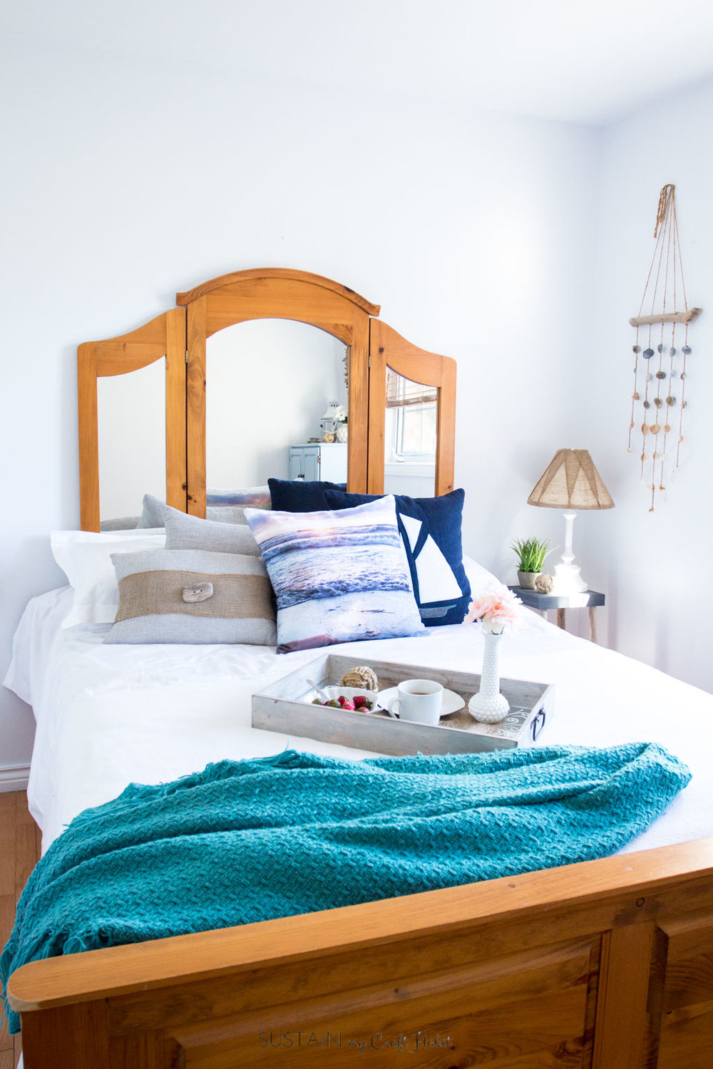 Almost 15 DIY coastal cottage decorating ideas in this one bedroom! Check out how you can create your own serene oasis of relaxation on a budget. Video tour included!