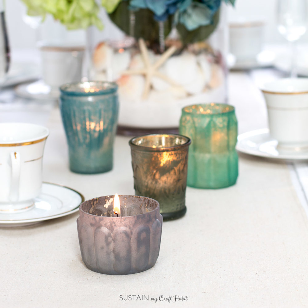 Mercury glass tealight holders. The perfect accent for a beach theme centerpiece and tablescape. Learn to make your own with this fun video tutorial. #afloral #sponsored