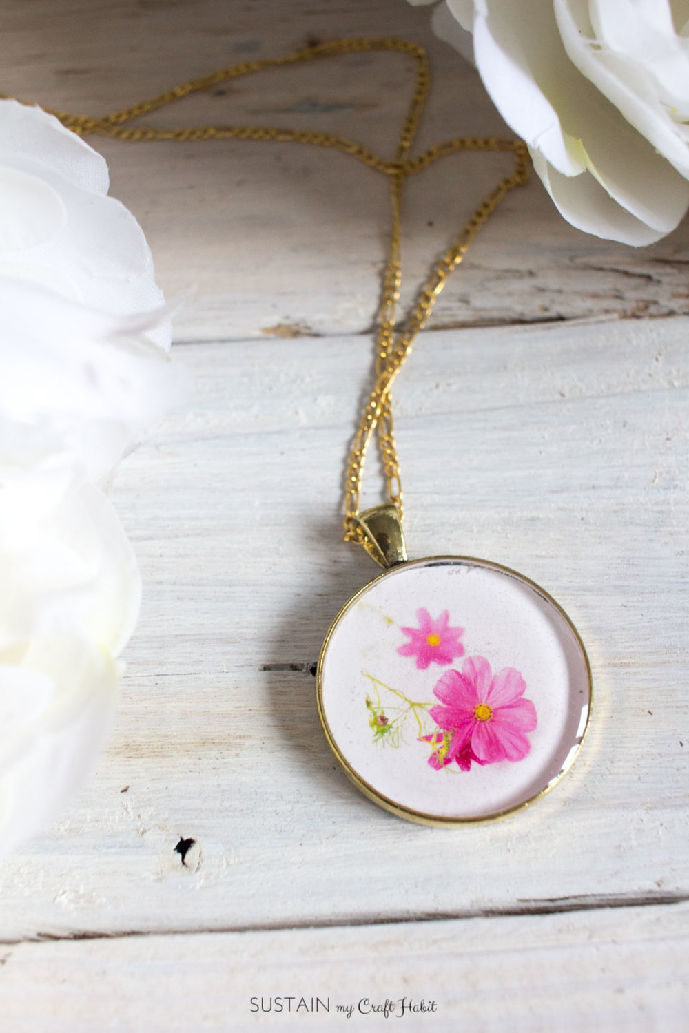 Learn how to make resin jewelry with this simple DIY tutorial. Use an image of the birth month flower of the person you are giving the pendant to for a truly unique and thoughtful gift idea.