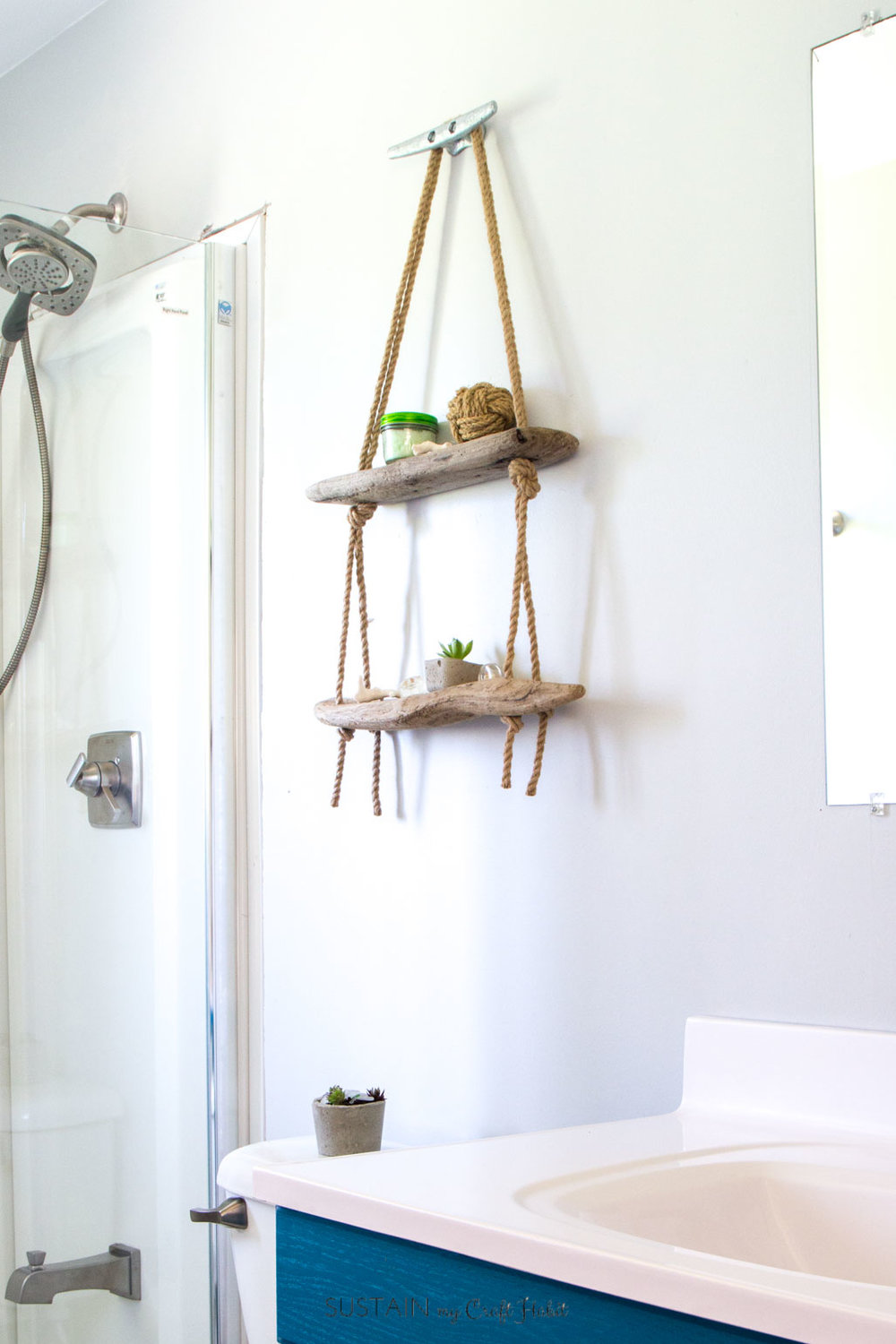 Learn how to make a hanging shelf with rope and driftwood. The perfect nautical decor for the lake house or cottage!