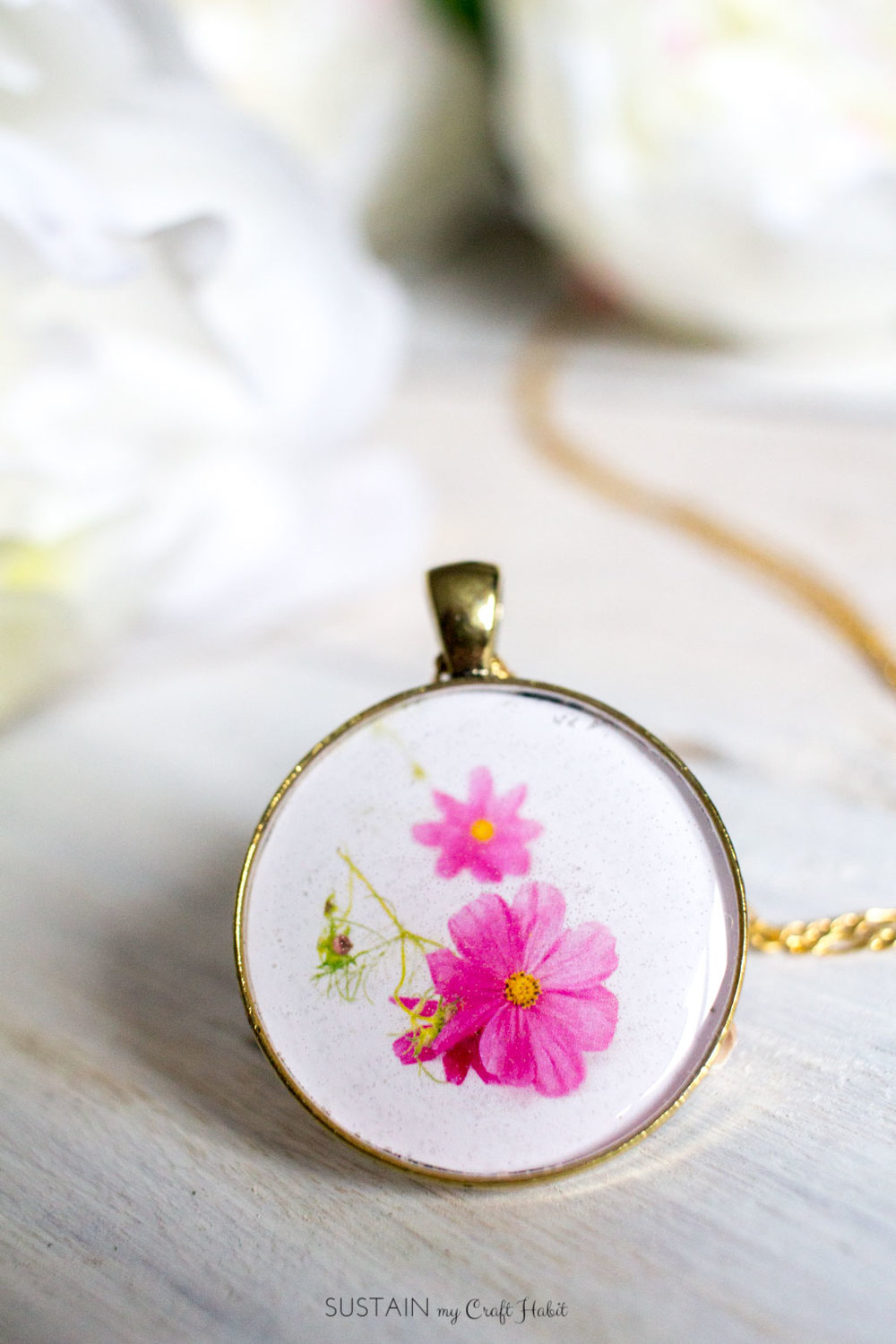 Learn how to make your own birth month flower resin jewelry. A thoughtful and unique gift idea for her for Mother's Day, a birthday, bridesmaids or Christmas. [ad]
