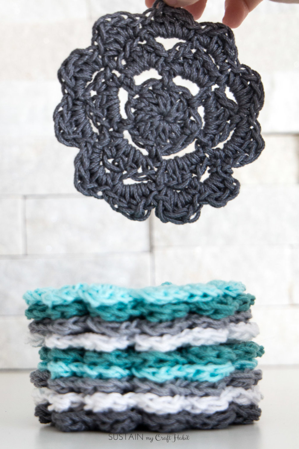 These easy crochet coasters were made with Lion Brand 24/7 Cotton yarn. Check out the review for a beach cover up using the same yarn and grab the free pattern for this crochet round.. #ad