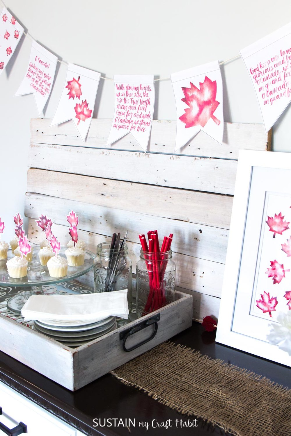 DIY Canada Day decorating ideas including free printable art and hand lettered banner.