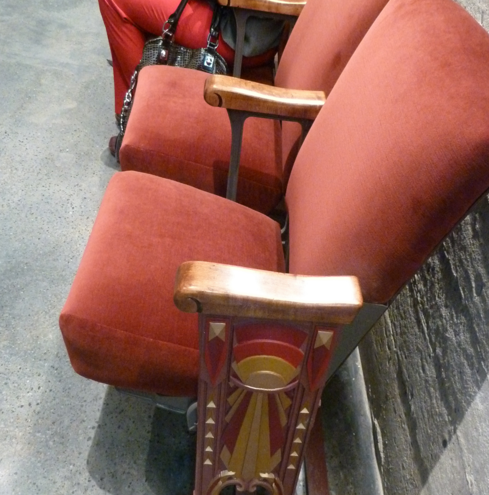 Vintage seats were restored for restroom waiting area.