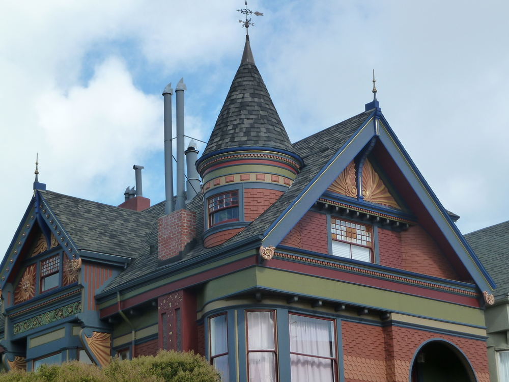 A Queen Anne with stained glass and a tower at Page and Ashbury.