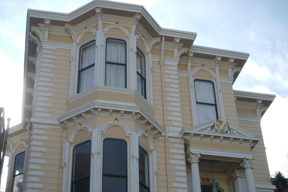 Italianate with quoins that mimic stone edges, on Liberty St in the Mission.