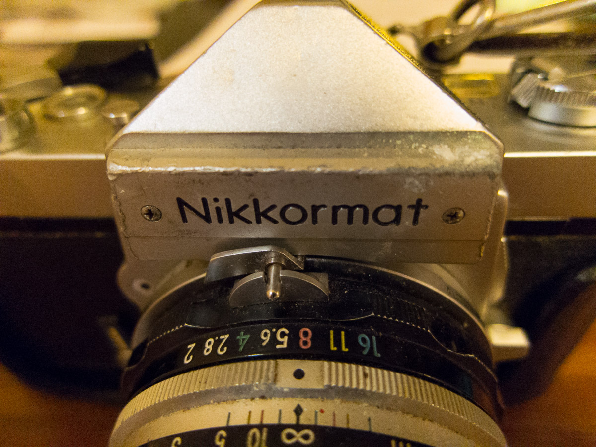 There are some scrapes ans scuffs on the top of the Nikkormat from the nearly 25 years of use.
