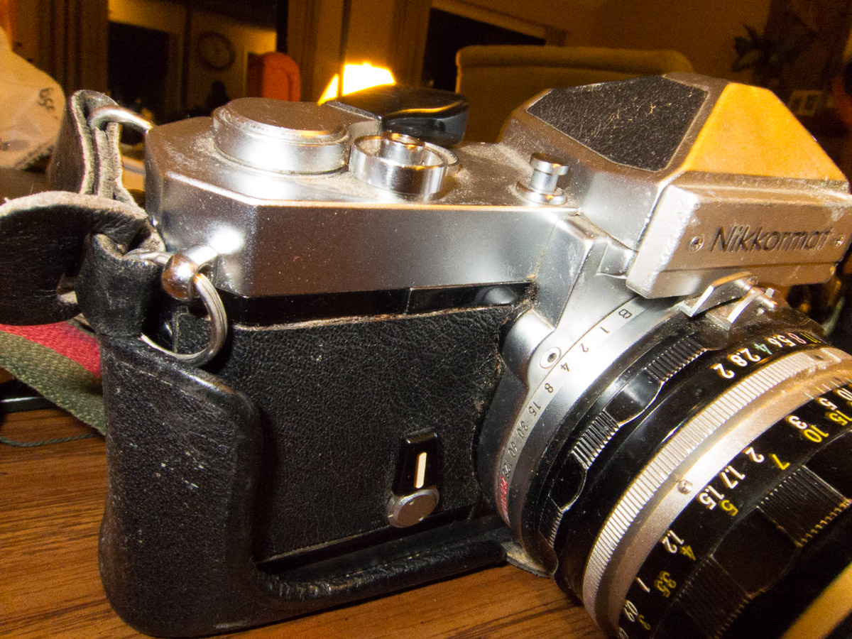 The front of the Nikkormat shows some brassing and deterioration of the leather cover.