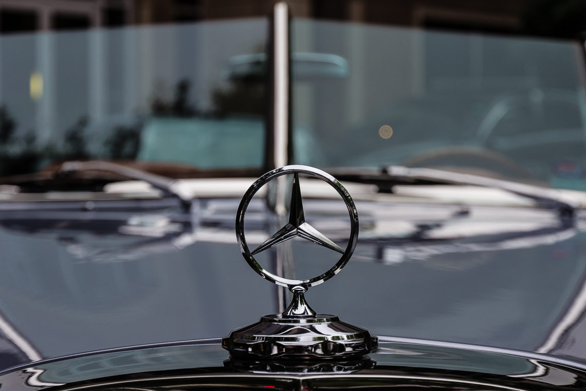 The Iconic Three Pointed Star Hood Ornament On A Vintage Mercedes Benz