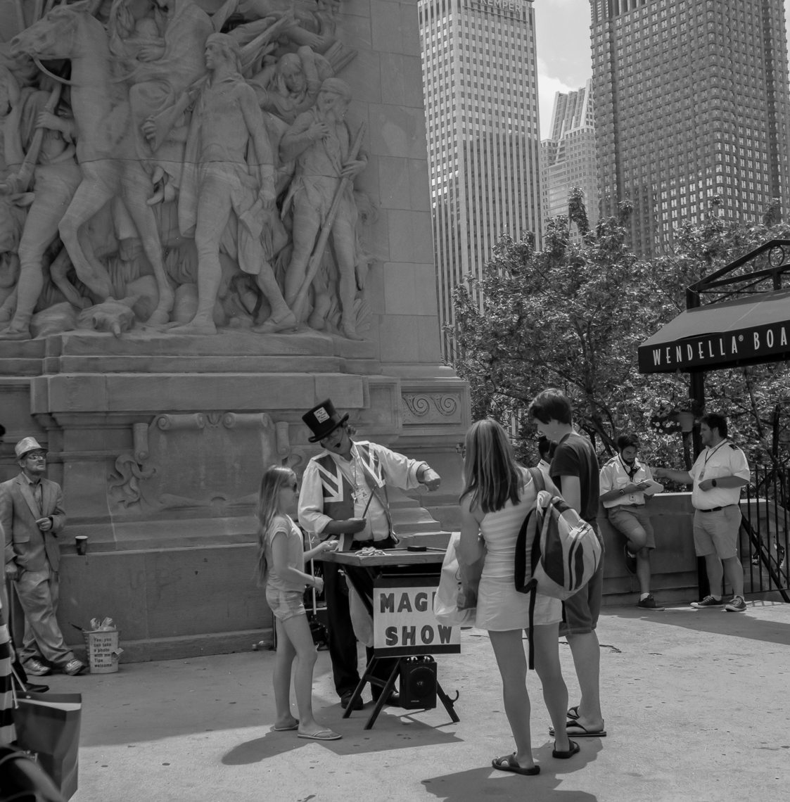 A Magic Show On The Street Corner Near The Wrigley Building In Chicago