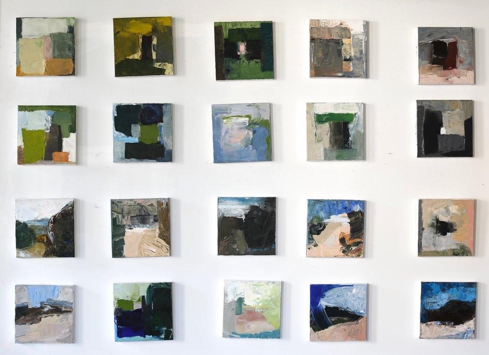"12"" paintings on studio wall"