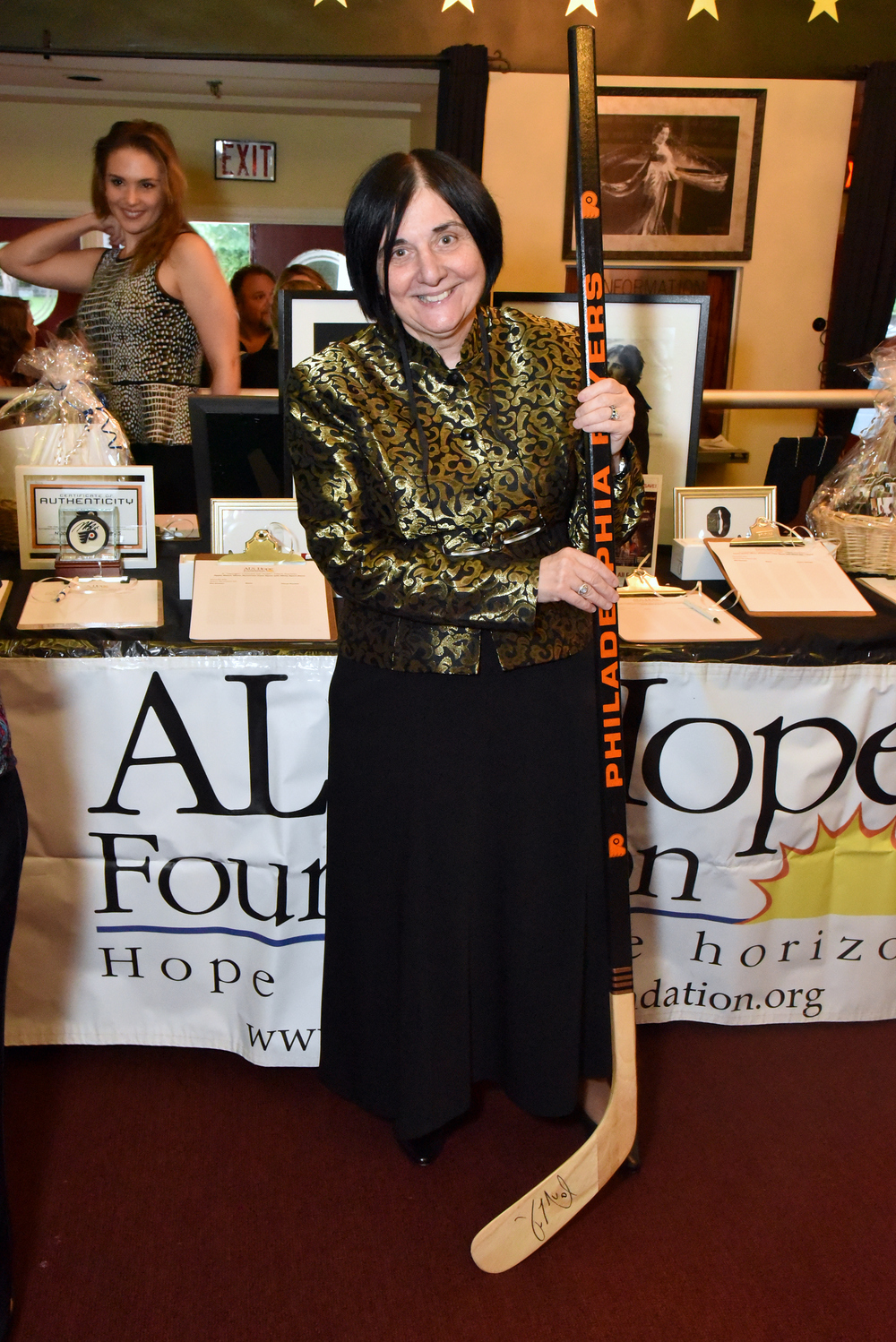 Dr. Terry Heiman-Patterson poses with auction items; photo credit: Robert E. Patterson