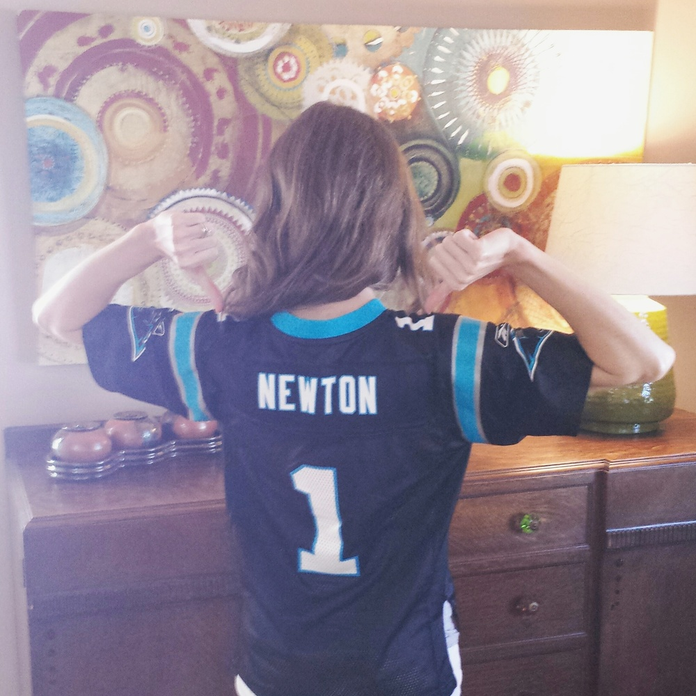 """Panther fans celebrate """"Black Friday"""" every Friday during football season.Please note that the Rooted ID team does not officially endorse the Carolina Panthers (even though they should)... Natalie, our New Orleans girl, is an avid Saints supporter."""