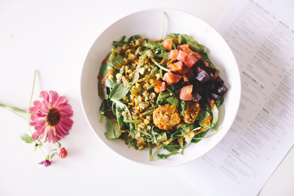 ARUGULA BEET: organic arugula ~ organic spinach ~ roasted organic beets ~ goat cheese ~ pistachio    ||     dressing: roasted carrot vinaigrette   ||    8.95    * suggested add-ons: avocado, brussel sprouts & bacon