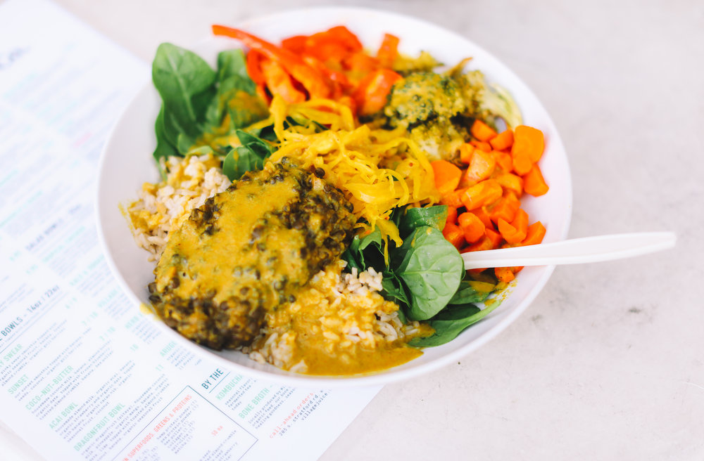 COCONUT CURRY BOWL: organic spinach ~ brown rice ~ organic roasted broccoli ~  organic roasted carrot ~  organic roasted red pepper ~curried black lentils ~ gnomestead hollow curry kraut || dressing: young coconut curry sauce || $11.00