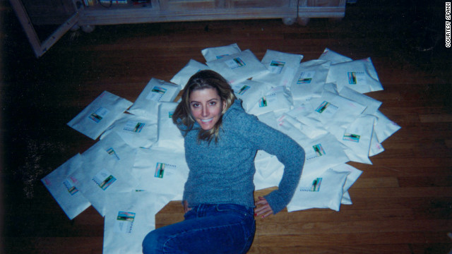 Sara on the floor of her apartment with an early order of SPANX