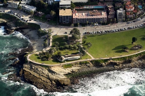 La Jolla Cove is the cove on the left side of the photo. Note the sparkling turquoise waters of La Jolla. Aerial photo by Darryl Kimball.