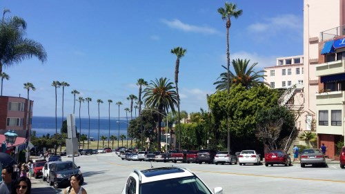 Shoppers leaving La Jolla Cove and walking into the shopping and art district of La Jolla