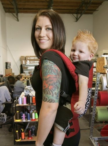 Robyn Collar & son in her Oceanside Ca. factory. Photo credit- San Diego Union Tribune