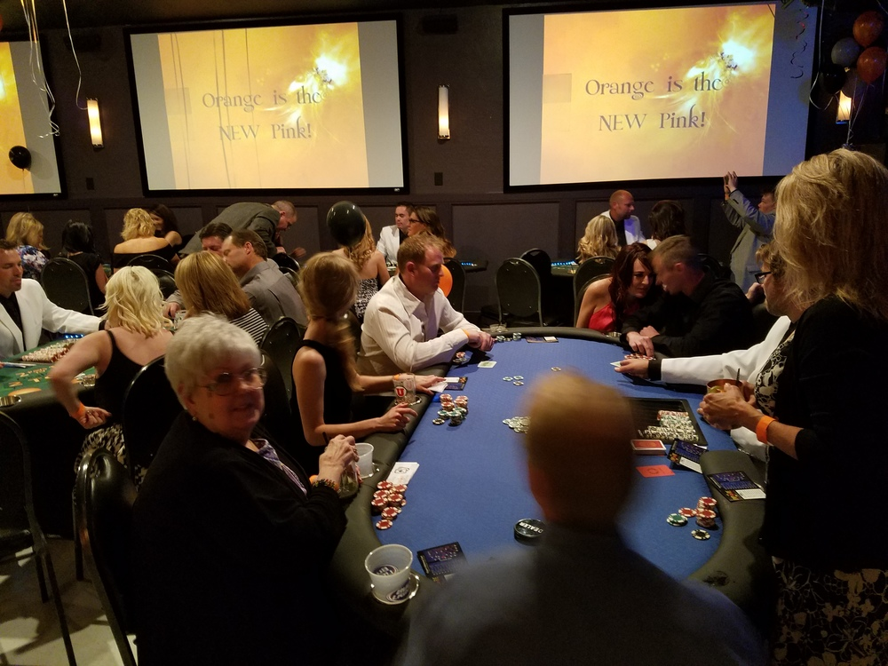 Scott is teaching texas holdem to guests eager to rake in their winnings