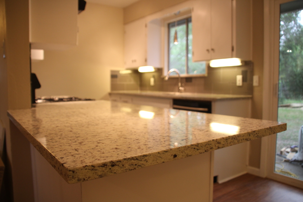 i compare the two products on five key points with a summary at the end - Granite Versus Quartz