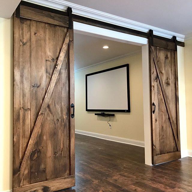 Custom barn doors installed in the latest basement remodel #barndoors #custom #door #carpentry #woodworking #woodshop #construction #basement #mancave #movietheater #tools #kampferconstruction #wood