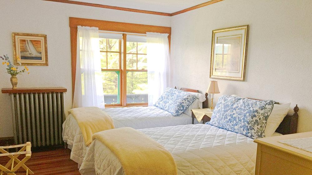 Yellow Bedroom sleeps 2; choose a king or 2 twin beds. Bathroom adjoins.