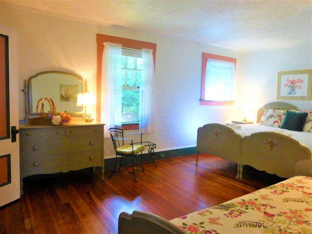Pink Bedroom sleeps 3; choose 3 twins or a king + 1 twin.
